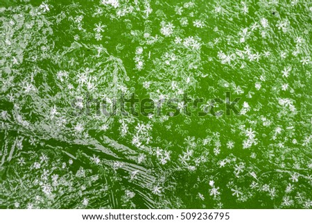 Holiday winter green background with Christmas white snowflakes
