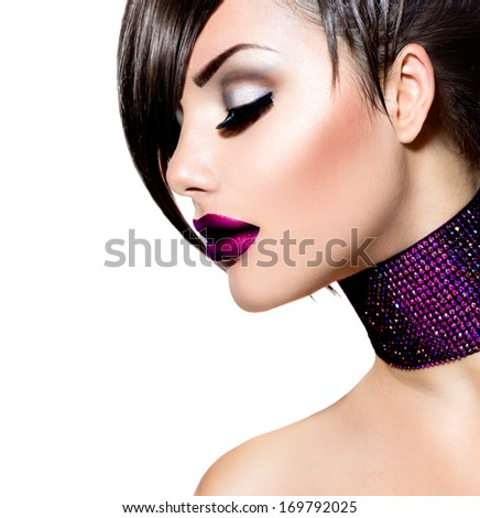 Holiday Woman Make up. Fashion Beauty Fashion Girl. Gorgeous Woman Portrait. Stylish Fringe Haircut and Makeup. Hairstyle. Vogue Style. Sexy Glamour Punk Girl with Smooth Skin and Dark Makeup  - stock photo