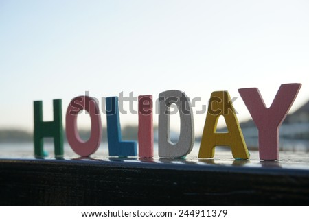 holiday word- text in letter wood