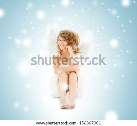 holidays and costumes concept - happy teenage angel girl - stock photo