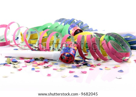 holidays and party time paper confetti with streamers and party blowers on white background - stock photo