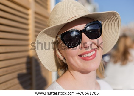 Holidays and vacation. Lovely cute woman tourist enjoying free time in caffee beside  sunny beach. Young girl enjoy her free time in caffee