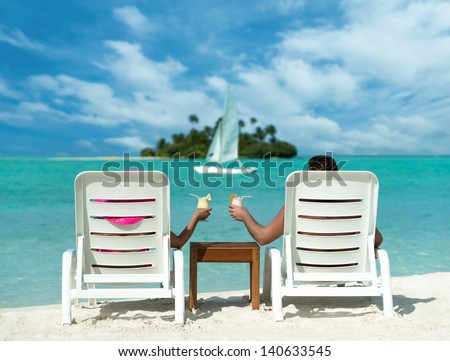 Holidays at the seaside with cocktails on the background of the island and yacht - stock photo