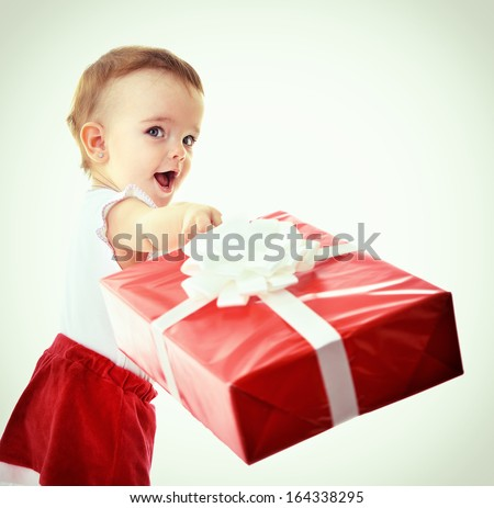 Holidays, baby girl make a present, christmas, birthday, new year, x-mas concept - happy child girl with gift boxes, toned - stock photo