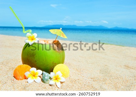 Holidays Background. Ocean beach with palm and and coctail - stock photo