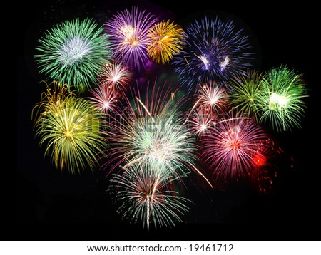 Holidays celebration fireworks displaying against black sky - stock photo