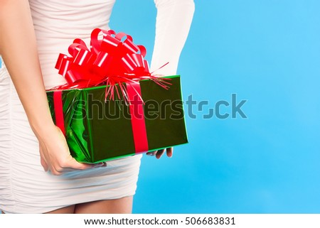 Holidays, celebrations, present, christmas, new year concept. close up hands with gift box.