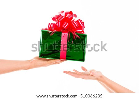 Holidays, celebrations, present, christmas, new year concept. close up hands with gift box