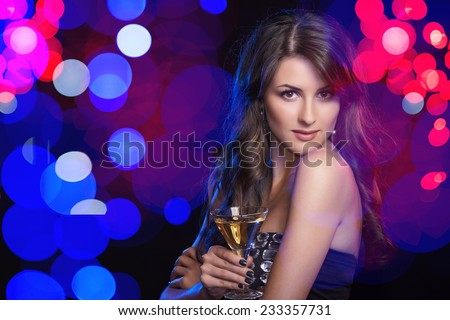 Holidays, christmas, people celebration concept. Closeup of sensual woman in evening dress with glass over holidays lights bokeh background - stock photo