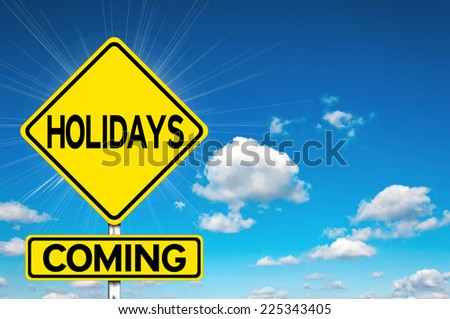 Holidays coming sign yellow road sign with clouds and sky in background  - stock photo