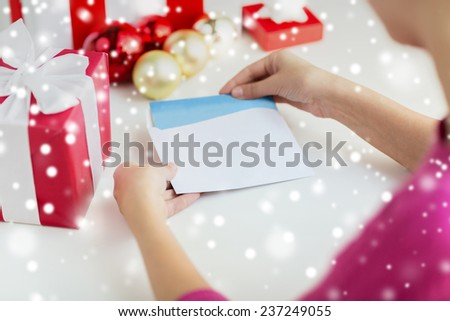 holidays, communication and people concept - close up of woman with letter and presents - stock photo