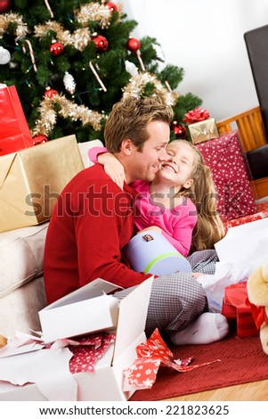 Holidays: Father Gets Hugs For Great Christmas Gift - stock photo