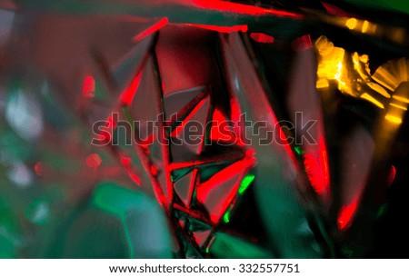 holidays, illumination and decoration concept - illuminated glass pattern bokeh over dark - stock photo