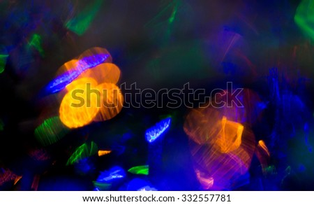 holidays, illumination and electricity concept - colorful bright night lights bokeh over dark background - stock photo