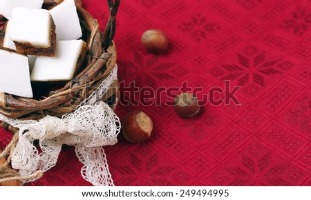 Holidays, love, food and drink concept. Handmade cookies in a basket on a red table in a vintage style. Selective focus, copy space background - stock photo