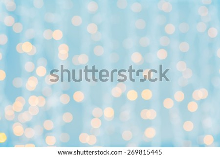 holidays, party and celebration concept - blurred blue and golden background with bokeh lights - stock photo