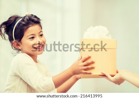 holidays, presents, christmas, x-mas and birthday concept - happy child girl with gift box - stock photo