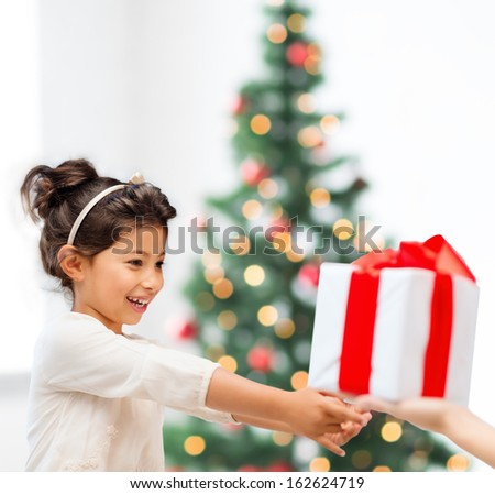 holidays, presents, christmas, x-mas, birthday concept - happy child girl with gift box - stock photo