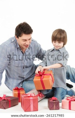 holidays, presents, christmas, x-mas, birthday concept - happy father and son with gift box - stock photo