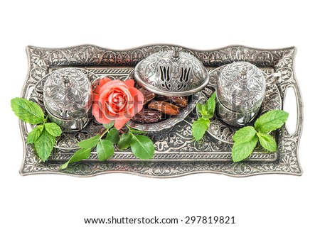 Holidays tea table setting with dates, mint leaves and rose flower. Ramadan karim. Oriental hospitality concept - stock photo