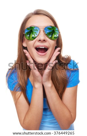 Holidays, travel, vacation concept. Surprised woman in sunglasses with tropical resort beach reflection with hands on cheeks - stock photo