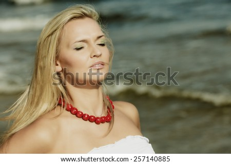 Holidays, vacation travel and freedom concept. Beautiful girl in white dress on beach. Lovely woman portrait outdoor on sea background