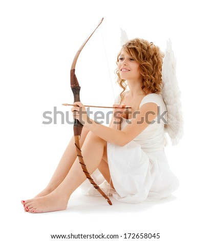 holidays, valentines day and costumes concept - happy teenage cupid girl with bow and arrow - stock photo