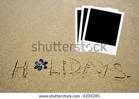 holidays written in the sandy beach  with a group of photos - stock photo