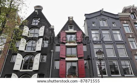 Holland, Amsterdam, the facade of old private stone houses downtown