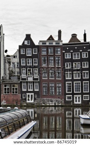 Holland, Amsterdam, view of one of the many canals and the facades of old stone houses