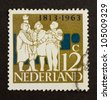 HOLLAND - CIRCA 1960: Stamp printed in the Netherlands shows a drawing on two men shaking hands, circa 1960 - stock photo