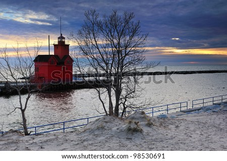 Holland Harbor Lighthouse Sunset, Michigan USA - stock photo