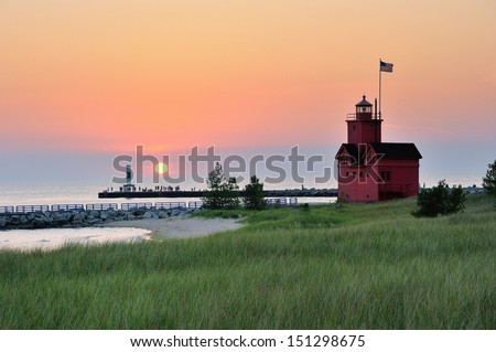 Holland Michigan Lighthouse sunset . Also known as Big Red. - stock photo