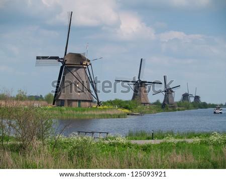 holland rural windmills, molens van kinderdijk - stock photo