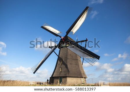 holland windmill on canal old mill stock photo edit now 588013397