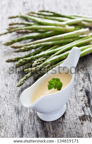 hollandaise and asparagus - stock photo