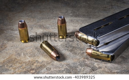 Hollow point ammunition with magazines for a semi automatic handgun - stock photo