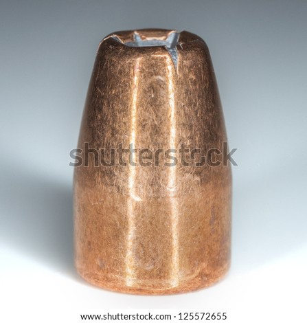 hollow point bullet on white - stock photo