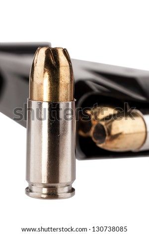 Hollow-point bullets and magazine - stock photo
