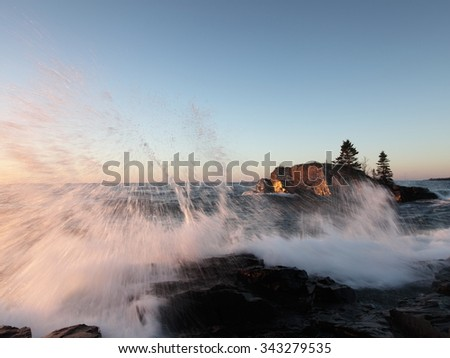 Hollow Rock at sunrise on the Lake Superior north shore in Minnesota - stock photo