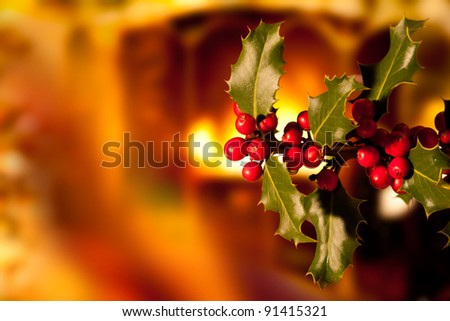 Holly Branch with Red Berries in a Warm House Interior - stock photo