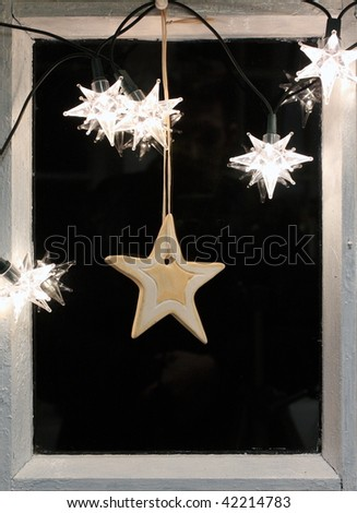 Holly night in frame of old windows with xmas decoration