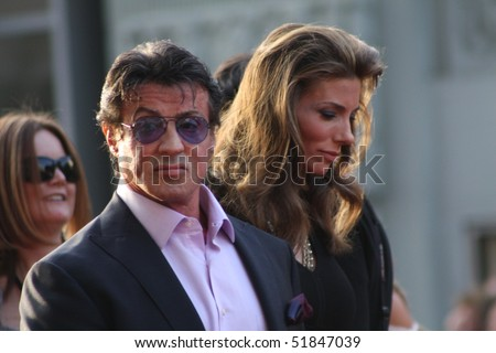 "HOLLYWOOD - APRIL 26: Actor Sylvester Stallone with wife at the premiere of the movie ""Ironman 2"" April 26, 2010 in Hollywood, California - stock photo"