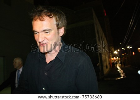 HOLLYWOOD - APRIL 21: Director Quentin Tarantino leaves the Jimmy Kimmel Studios on April 21, 2011 in Hollywood, CA. - stock photo