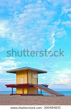 Hollywood Beach Florida, USA. Colorful lifeguard house at sunset with beautiful summer sky and ocean in the background - stock photo