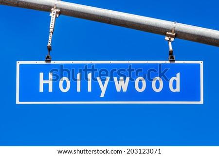 Hollywood Blvd overhead street sign against blue sky, California, USA - stock photo