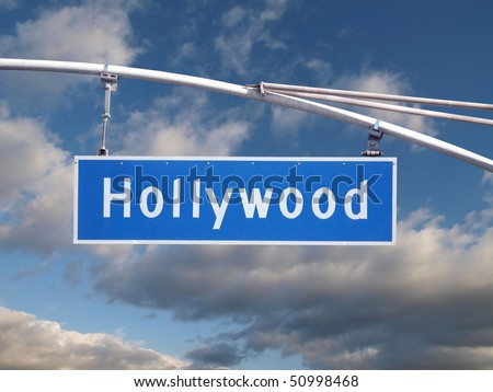 Hollywood Blvd street sign with dramatic winter sky. - stock photo