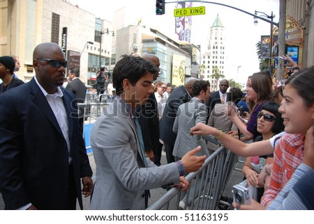 """HOLLYWOOD, CA- APRIL 17: Singer Joe Jonas arrives at the premiere of the movie """"Oceans"""" at the El Capitan theatre, April 17, 2010 in Hollywood, CA. - stock photo"""