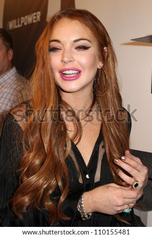 HOLLYWOOD, CA - AUGUST 13: Lindsay Lohan arrives at the will.i.am Album Wrap Party at The Avalon on August 13, 2012 in Hollywood, California. - stock photo