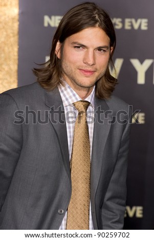 "HOLLYWOOD, CA - DECEMBER 5: Actor Ashton Kutcher arrives at the premiere of ""New Year's Eve"" at Grauman's Chinese Theater on December 5, 2011 in Hollywood, California - stock photo"